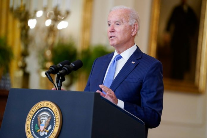 Biden urges Congress hike taxes on higher income Americans for spending bill
