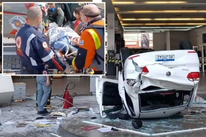 Volkswagen topples into receptionist at car dealership
