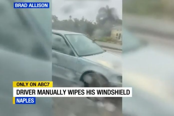 Florida man caught on video using hand as windshield wiper, community wants to help