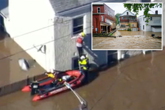 Boat crews rescue dozens trapped by storm in Pennsylvania