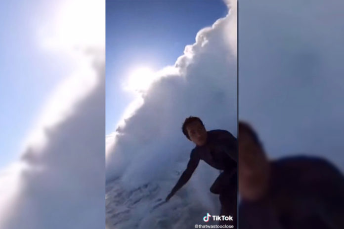 Surfer knocked over by series of monster waves in viral video