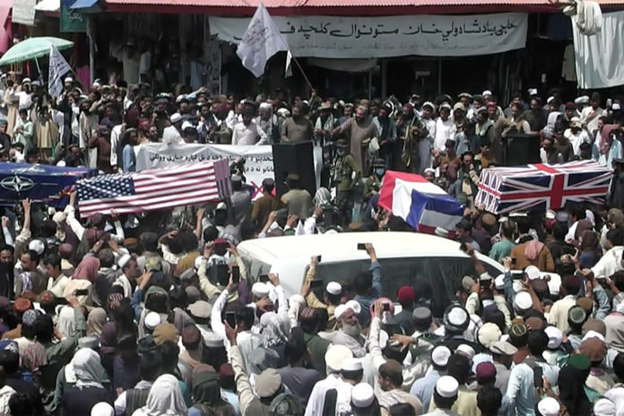 Taliban supporters hold mock funeral with American-flag draped coffins