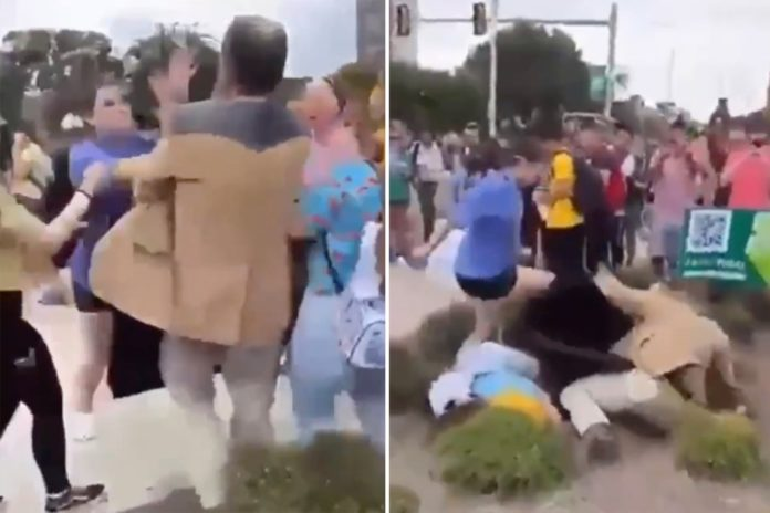 Student punches preacher holding 'mysogynistic' sign