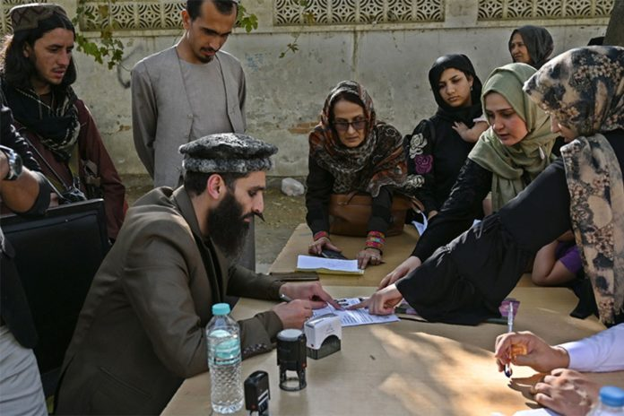 Afghans flock to Kabul passport office as Taliban allows travel