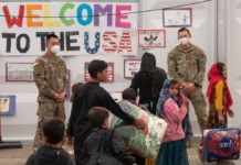 Afghan resettlement snarled by housing shortage, measles
