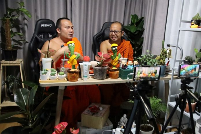Thai monks' livestream mixes Buddhism and jokes but not all are laughing