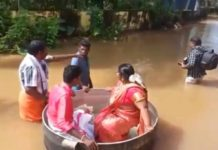 Indian couple float to wedding in giant cooking pot amid floods