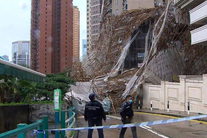 Scaffolding collapse in Hong Kong kills worker, traps motorists