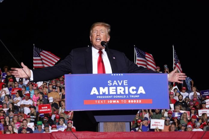 Trump tells crowd at Iowa rally 'we're going to take America back'